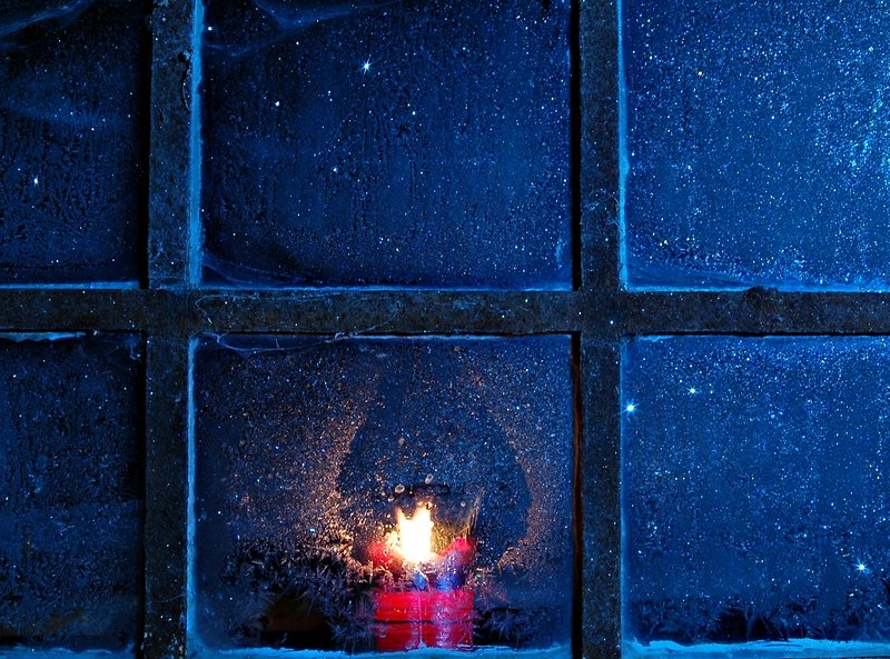188506-stock-photo-winter-window-ice-safety-frost-candle