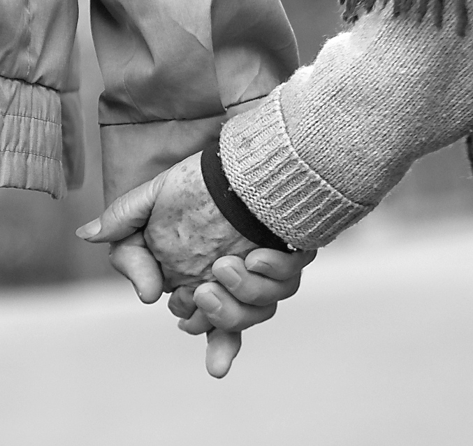 stock-old-couple-holding-hands-wintersmall1