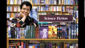 Science Fiction writer Octavia Butler poses for a photograph near some of her novels at University Book Store in Seattle, Wash., on Feb. 4, 2004. Butler, considered the first black woman to gain national prominence as a science fiction writer, died Friday, Feb. 24, 2006, after falling and striking her head on the cobbled walkway outside her Seattle home, a close friend said. She was 58. (AP Photo/ Seattle Post-Intelligencer, Joshua Trujillo)