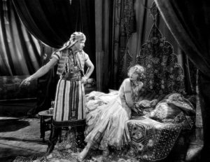 From the 1921 adaptation of The Sheik with Rudolph Valentino and Agnes Ayres, an enormously popular rape fantasy story